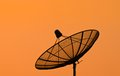 Satellite dish with sunset background Stock Image