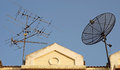 Satellite dish and television antenna on roof Royalty Free Stock Photo