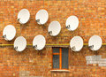 Satellite dish on the wall Royalty Free Stock Photo