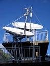 Satellite dishes, antennas on blue sky. Stock Photo