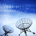 Satellite dishes with blue sky Stock Images