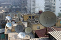 Satellite dishes in cairo egypt mars on the roofs at Royalty Free Stock Image