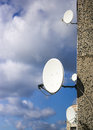 Satellite dishes on the house wall Royalty Free Stock Photo