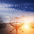 Satellite dishes with sunset Stock Photos