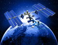 Satellite space station with earth and sun light background Royalty Free Stock Photos