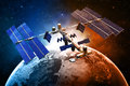 Satellite space station with earth and sun light background Stock Image