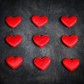Satin red hearts on a dark background. Valentine`s Day card. Royalty Free Stock Photo