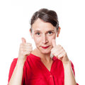 Satisfaction concept for shy 30s woman with thumbs up Royalty Free Stock Photo