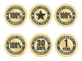 Satisfaction guarantee seals set of golden Stock Photography