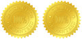 Satisfaction and quality guaranteed gold seals with embossed decorations Royalty Free Stock Photo
