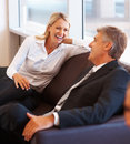 Satisfied business executives having fun Stock Image