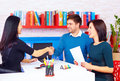 Satisfied clients couple after successful business negotiations in office the Royalty Free Stock Image