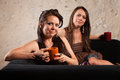 Satisfied Coffee Drinkers on Sofa Royalty Free Stock Photography