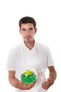 Satisfied cook in white overalls holding glass bowl Stock Photo