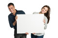 Satisfied couple holding white sign mature looking at camera with isolated on background Royalty Free Stock Photos