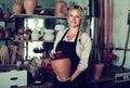 Satisfied female artisan having ceramics in workshop Royalty Free Stock Photo