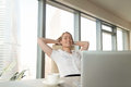 Satisfied happy businesswoman feeling relaxed in office chair, e Royalty Free Stock Photo