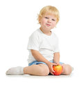 Satisfied kid eating apple on white Stock Photography
