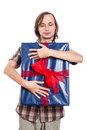 Satisfied man with big gift hugging blue box isolated on white background Royalty Free Stock Photo