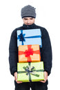 Satisfied man looking at presents in winter jacket isolated on white background Royalty Free Stock Photography