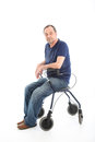 Satisfied man resting on a health walker Stock Photos