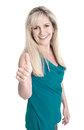 Satisfied middle aged woman isolated over white with thumbs up and happy wearing green shirt Royalty Free Stock Photos