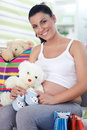 Satisfied pregnancy after shopping pregnant woman at home Royalty Free Stock Photo
