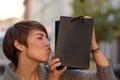 Satisfied shopper kissing her boutique bag