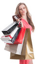 Satisfied shopping lady holding bags card and wallet on white background Stock Photo