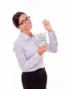 Satisfied and smiling businesswoman holding money brunette looking at camera while with a happy gesture wearing her straight Stock Images