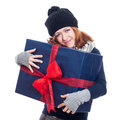 Satisfied winter woman with big present happy holding isolated on white background Royalty Free Stock Photo