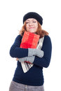 Satisfied winter woman with gift holding isolated on white background Royalty Free Stock Image