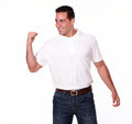 Satisfied young guy celebrating his victory portrait of a on white t shirt and jeans while standing and looking at people on Stock Image