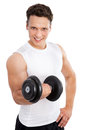 Satisfied young strength man lifting dumbbell isolated on white background Stock Photos