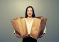 Satisfied young woman with paper bags Royalty Free Stock Photo