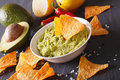 Sauce guacamole, nachos chips close-up and ingredients. Horizontal Royalty Free Stock Photo
