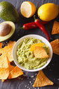 Sauce guacamole, nachos chips close-up and ingredients. vertical Royalty Free Stock Photo