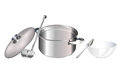 Saucepan and big spoon Stock Image