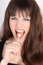 Saucy sexy girl licking lollipop Royalty Free Stock Images