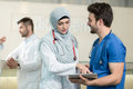 Saudi arab doctors working with a tablet. Royalty Free Stock Photo