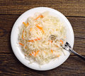 Sauerkraut with carrot in a plate Royalty Free Stock Images