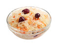 Sauerkraut with cranberries in a glass bowl isolated on white Stock Photos