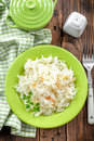 Sauerkraut on a plate on a wooden table Royalty Free Stock Image
