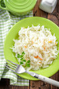 Sauerkraut on a plate on a wooden table Stock Images