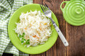 Sauerkraut on a plate on a wooden table Royalty Free Stock Photos
