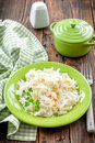 Sauerkraut on a plate on a wooden table Royalty Free Stock Photography