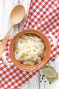 Sauerkraut in a pot on a table Royalty Free Stock Photography