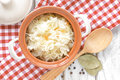 Sauerkraut in a pot on a table Royalty Free Stock Images