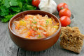 Sauerkraut soup in brown bowl on wooden table Stock Images