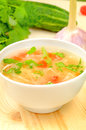 Sauerkraut soup in white bowl on wooden table Stock Image